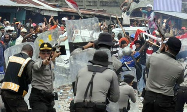 PHOTO: Indonesian police clash with striking miners in Timika,